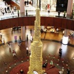 The monumental Burj Khalifa tower, emblematic of the Dubai skyline and the UAE more broadly, has been commodified as a symbol of Emirati modernity and economic achievement. In a surreal gesture, Dubai mall featured a three-story replica of the towering structure—formed entirely from Ferrero Rocher chocolates. -- December 2012;  Dubai, United Arab Emirates