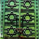 """Shuttered windows on a synagogue featuring the Star of David (read also as the """"Seal of Solomon"""" in Islamic traditions), in the downtown heart of the Tunisian capital. -- June 2012;  Tunis, Tunisia"""