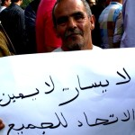 "As part of a massive pro-labor demonstration celebrated on May Day, thousands of Tunisians flooded Habib Bourguiba avenue, underscoring the need for post revolutionary unity.  This man's sign reads: ""No left, no right – unity for all."" -- May 2012; Tunis, Tunisia"
