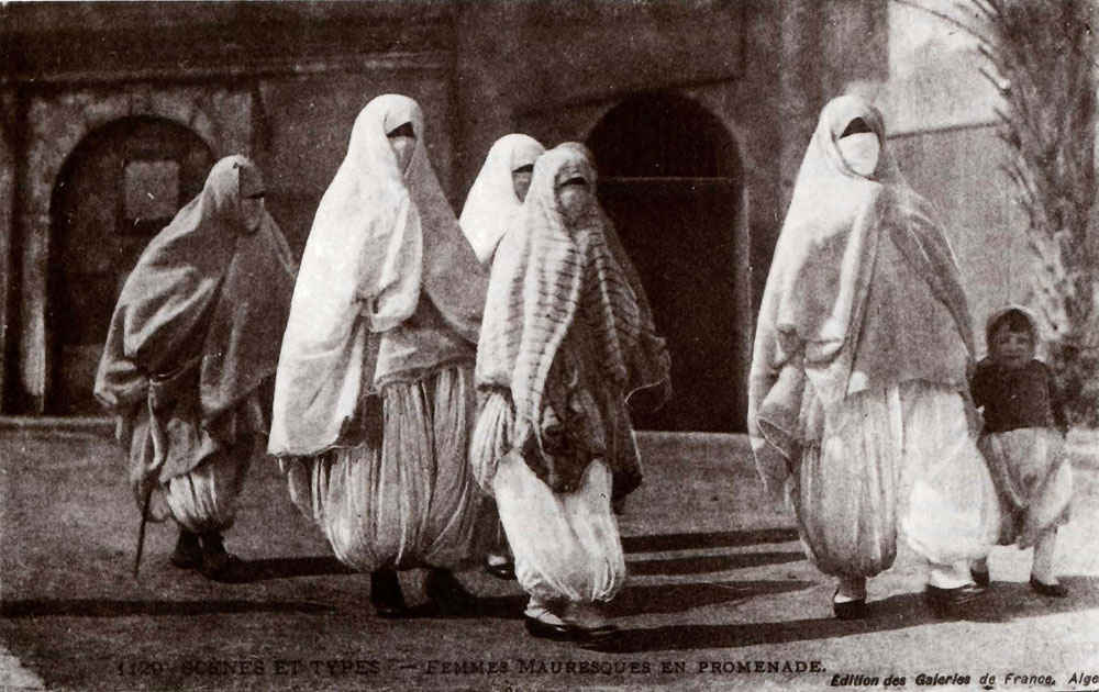 Moorish Women Taking a Walk. Postcard from The Colonial Harem, by Malek Alloula. Image Credit: http://veil.unc.edu/arts/visual-arts/orientalist-photography/colonial-harem/
