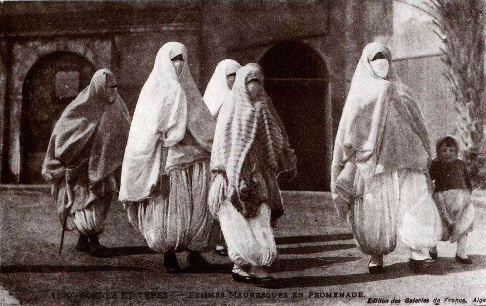Moorish Women Taking a Walk. Postcard from The Colonial Harem, by Malek Alloula. Image Credit: http://veil.unc.edu/arts/visual-arts/orientalist-photography/colonial-harem/
