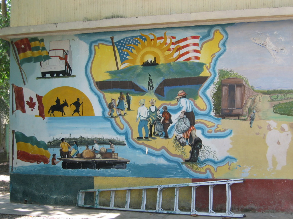 Image 4: Mural of the difficult northward journey, which depicts an imposing border with a narrow entryway between the United States and Mexico at the Casa del Migrante in Tecún Umán, Guatemala. - Photo Credit: Rebecca B. Galemba