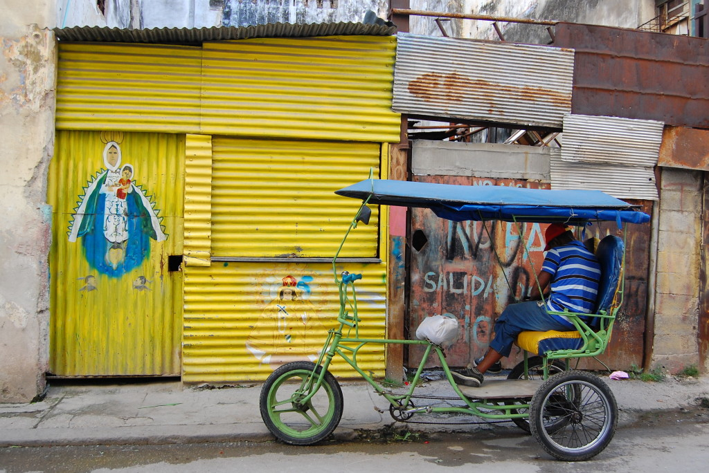 """Virgen of Charity and bike taxi"" - Photo credit: Miriam Psychas"